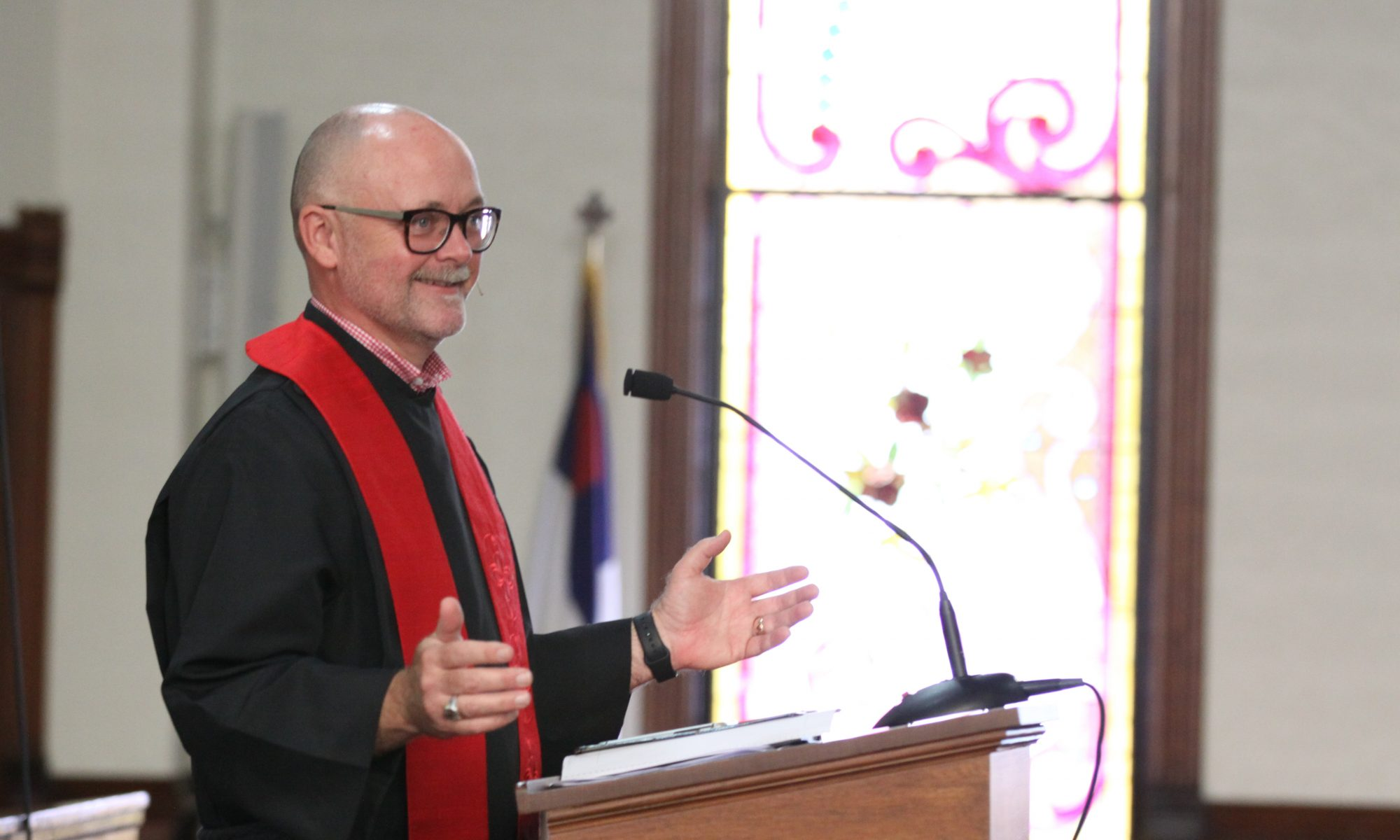 pastor john at the pulpit